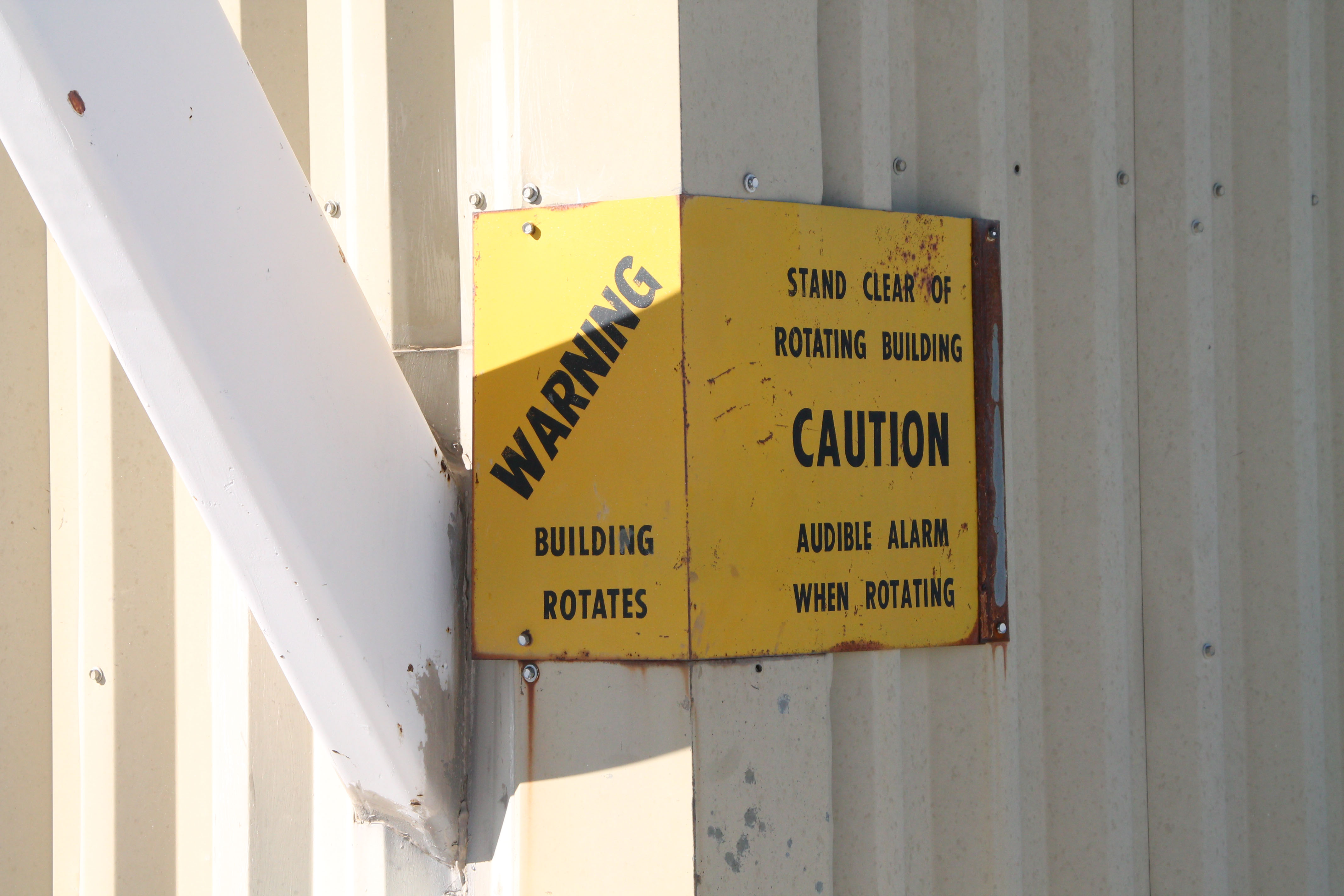 Warning moving building